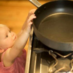 girl-reaching-stove