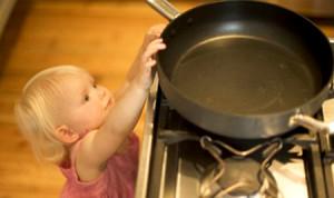 girl-reaching-stove